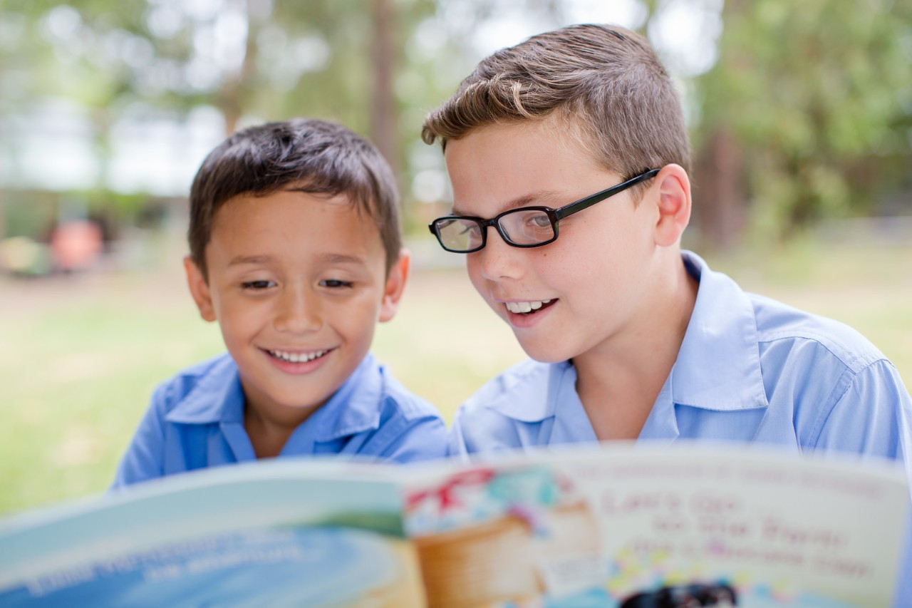 Two students reading together in the Buddy Reading program